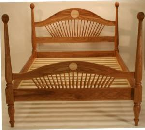 This full size bed is Vermont Black Cherry and Quilted Maple. Every available flat surface has been hand carved
