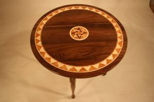 gate-leg table, about 36 in diameter. It folds to 9 wide. It is made of Pennsylvania Black Walnut, Vermont Birds-eye Maple and Vermont Black Cherry burl